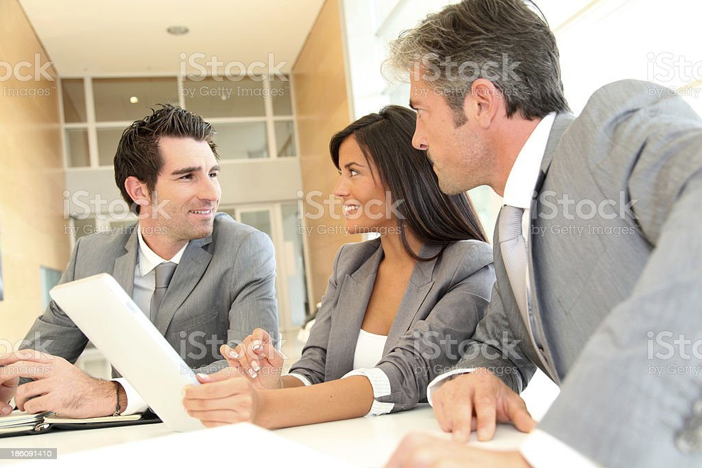 Happy business team working together royalty-free stock photo