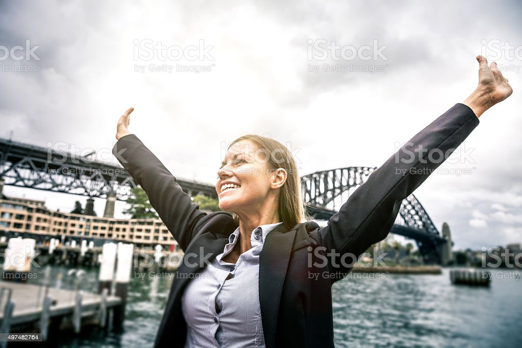 Happy business woman in Sydney stock photo