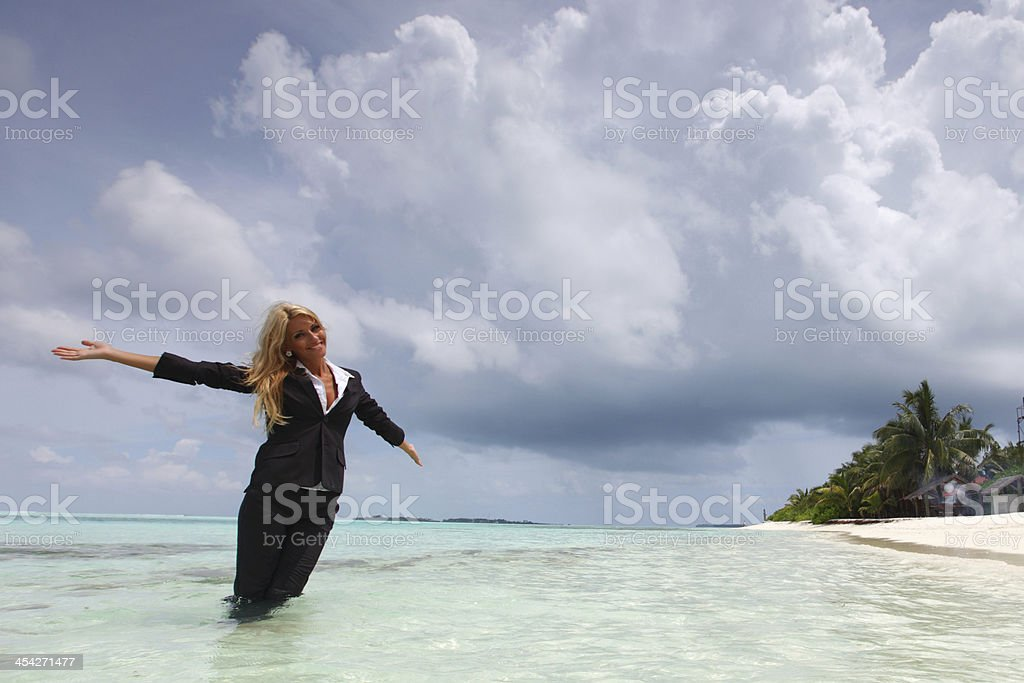 happy business woman on the ocean coast royalty-free stock photo