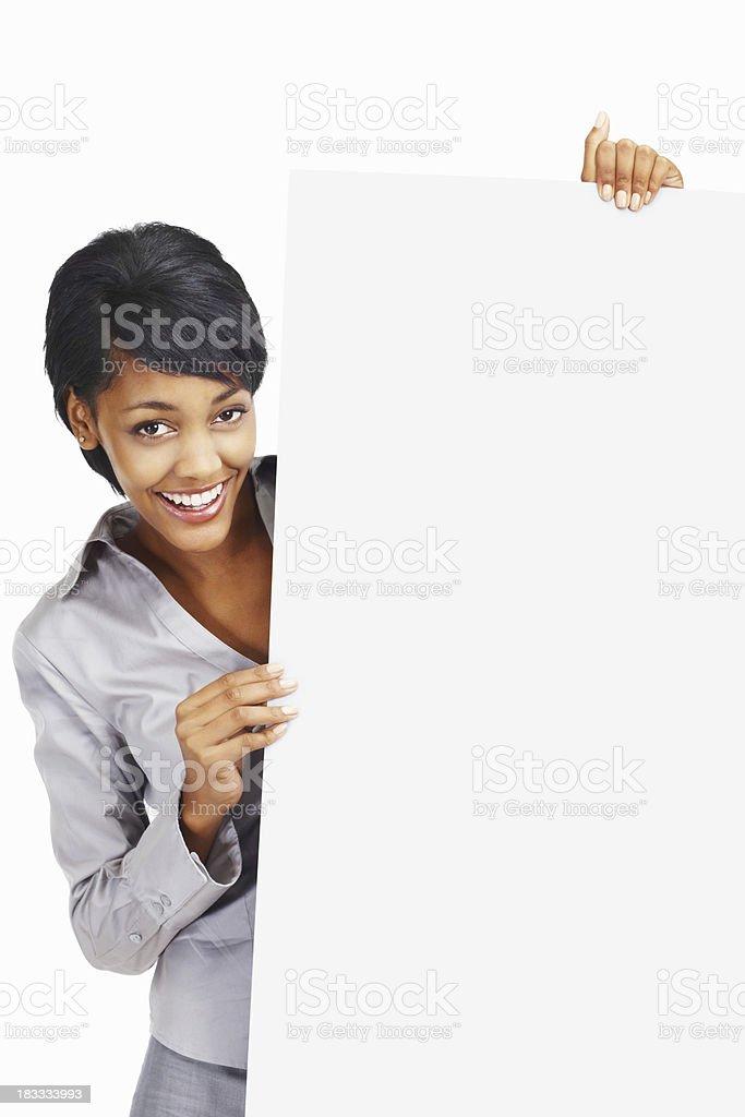 Happy business woman peeping through billboard royalty-free stock photo