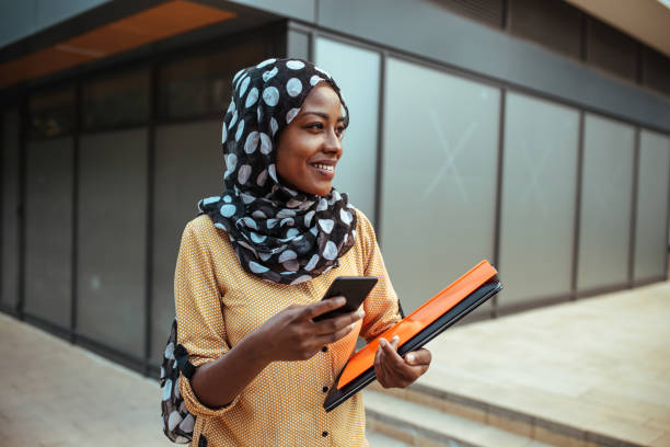 Happy business woman Spain, Businesswoman, African Ethnicity, Adult, Adults Only islam stock pictures, royalty-free photos & images