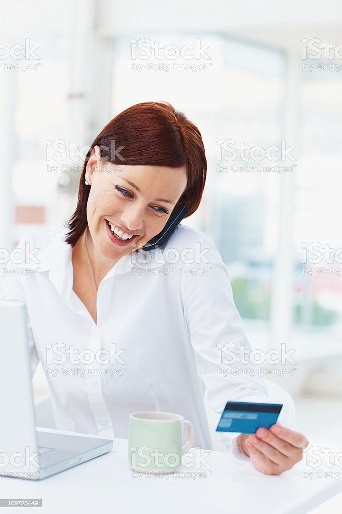 Happy business woman shopping online with a credit card royalty-free stock photo