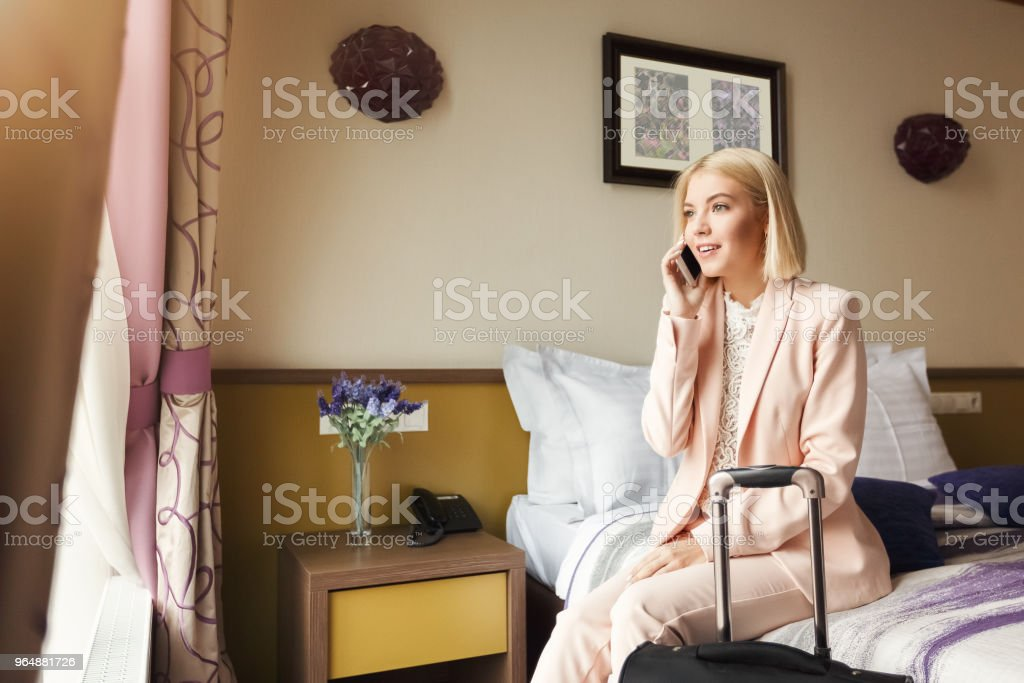 Happy business woman sitting in hotel room royalty-free stock photo