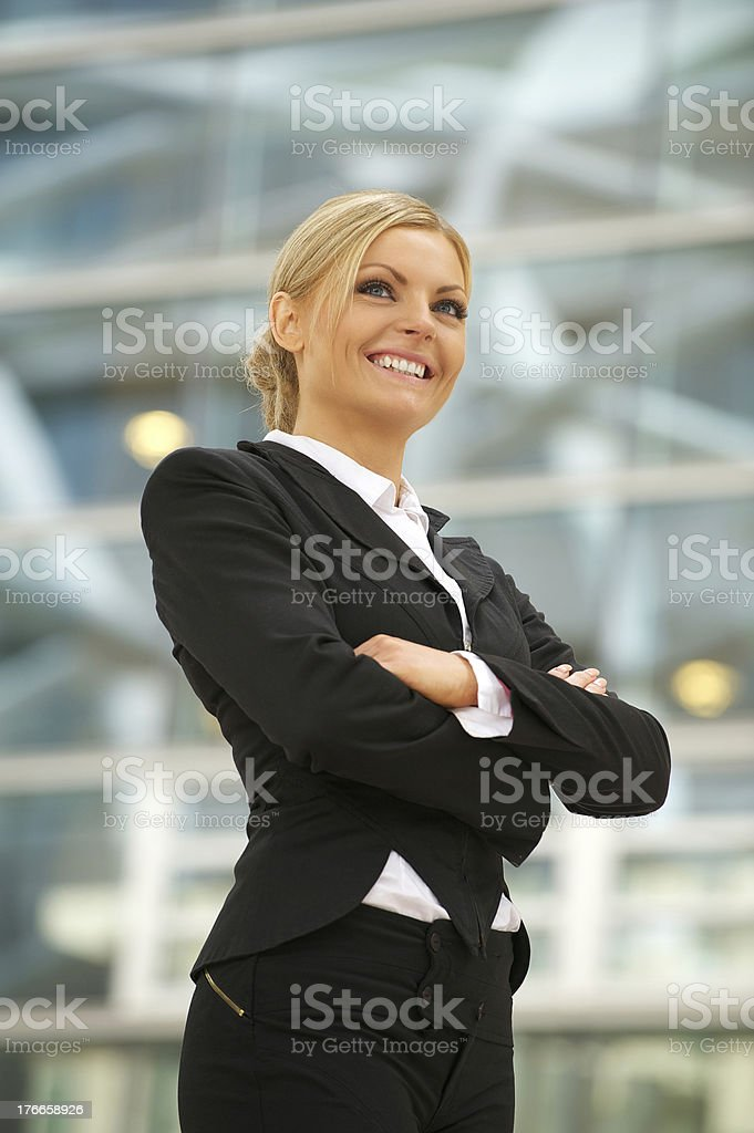 Happy business woman smiling in the city royalty-free stock photo