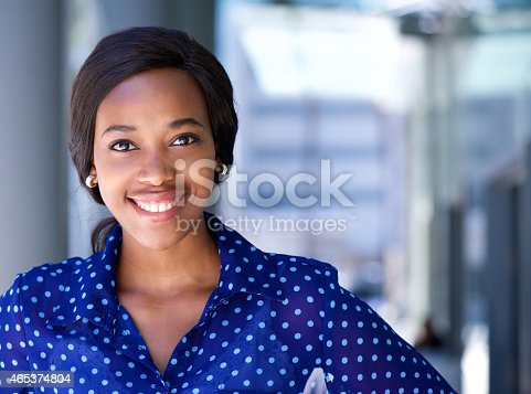 Close up portrait of a happy business woman smiling outside office building