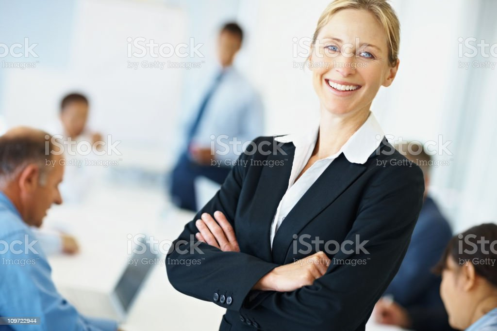 Happy business woman smiling with colleagues at the back royalty-free stock photo