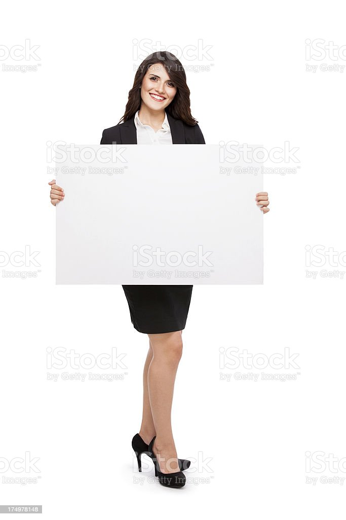 Happy business woman with a sign royalty-free stock photo