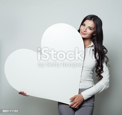 Happy business woman with white blank heart banner background