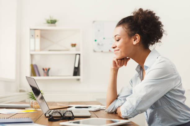 happy business woman working on laptop at office - benefits imagens e fotografias de stock