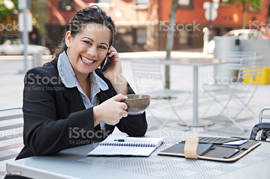Happy business woman working outside with coffee stock photo