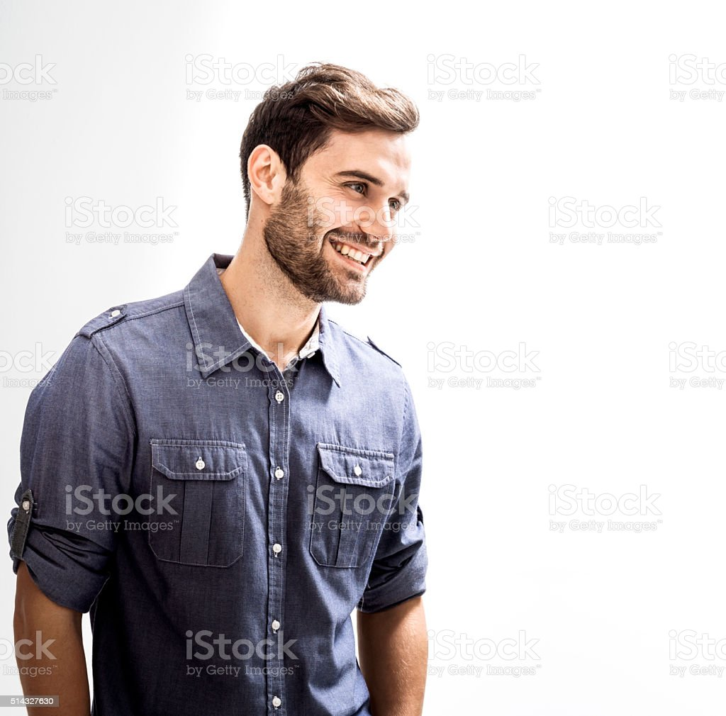 Happy businessman against white background stock photo