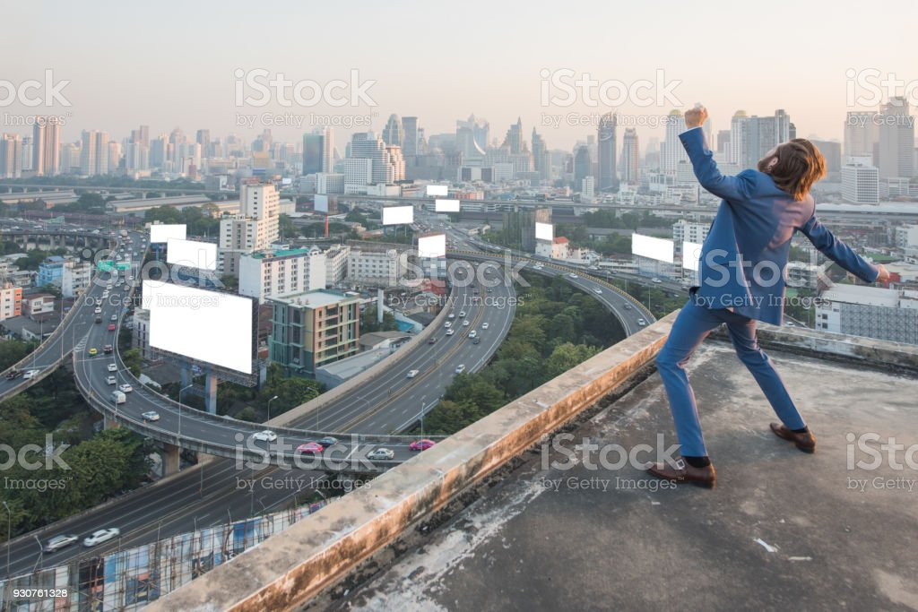 Happy Businessman bawl over cityscape,business successful concept stock photo