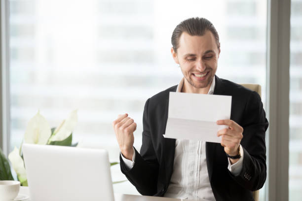 Cтоковое фото Happy businessman celebrates receiving good business news in letter.
