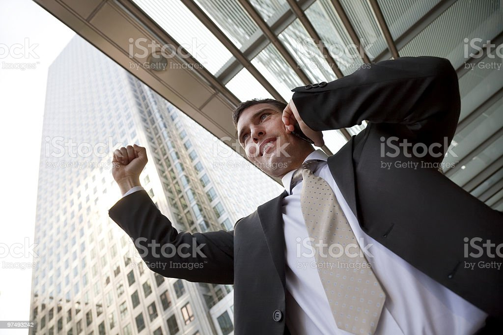 Happy Businessman Celebrating On Cell Phone In The City royalty-free stock photo