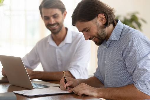 843533912 istock photo Happy businessman customer sign contract employment agreement at business meeting 1182933995