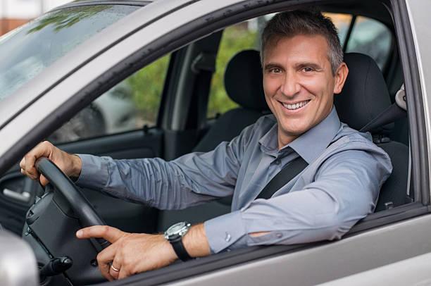 Happy Businessman Driving Car stock photo