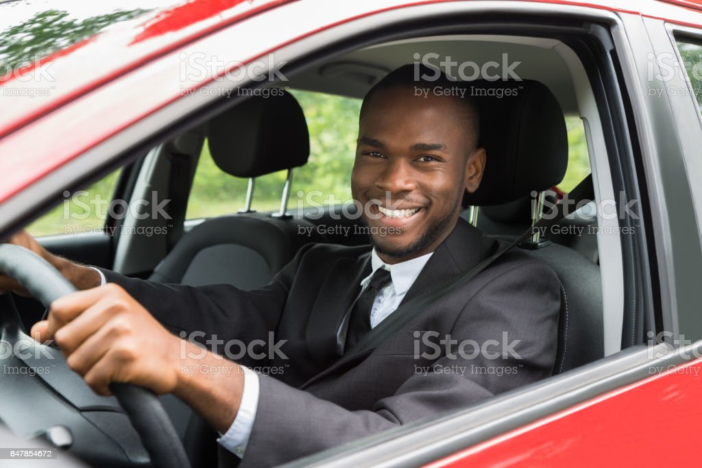 Happy Businessman Driving Car stock photo