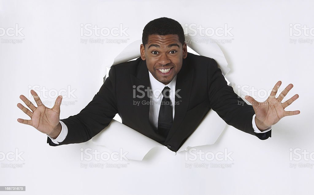 Happy businessman emerging through hole stock photo