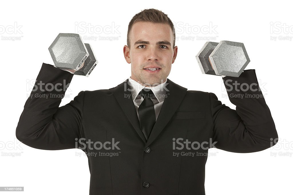 Happy businessman exercising with dumbbells royalty-free stock photo