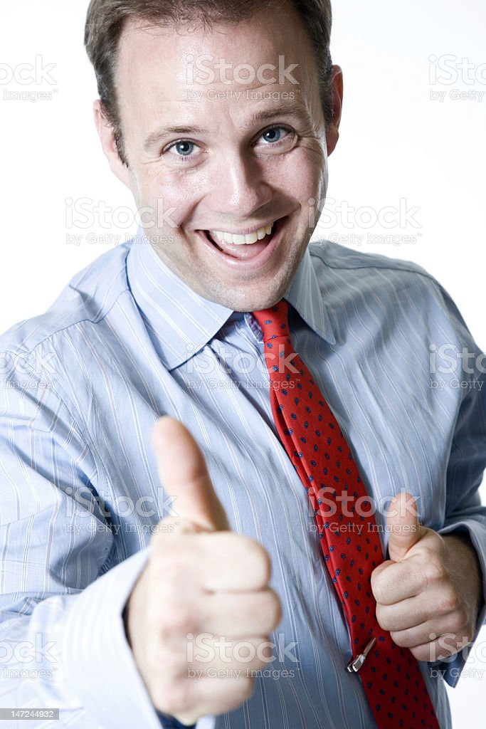 happy businessman giving the thumbs up sign stock photo