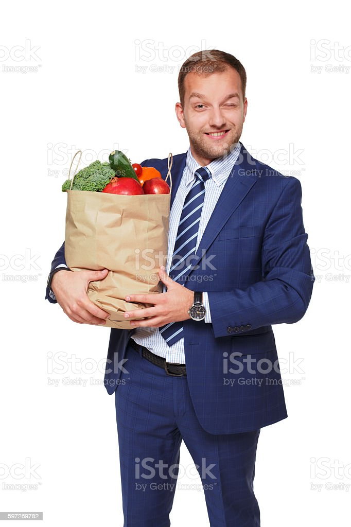 Happy businessman hold bag with healthy food, grocery buyer isolated royalty-free stock photo