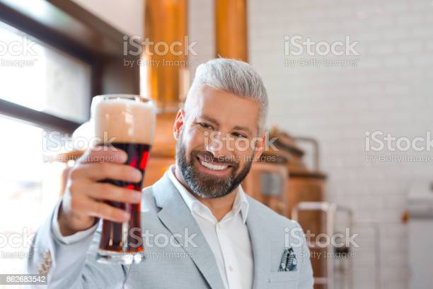 Happy Businessman Holding A Beer Glass In His Pub Stock Photo - Download Image Now