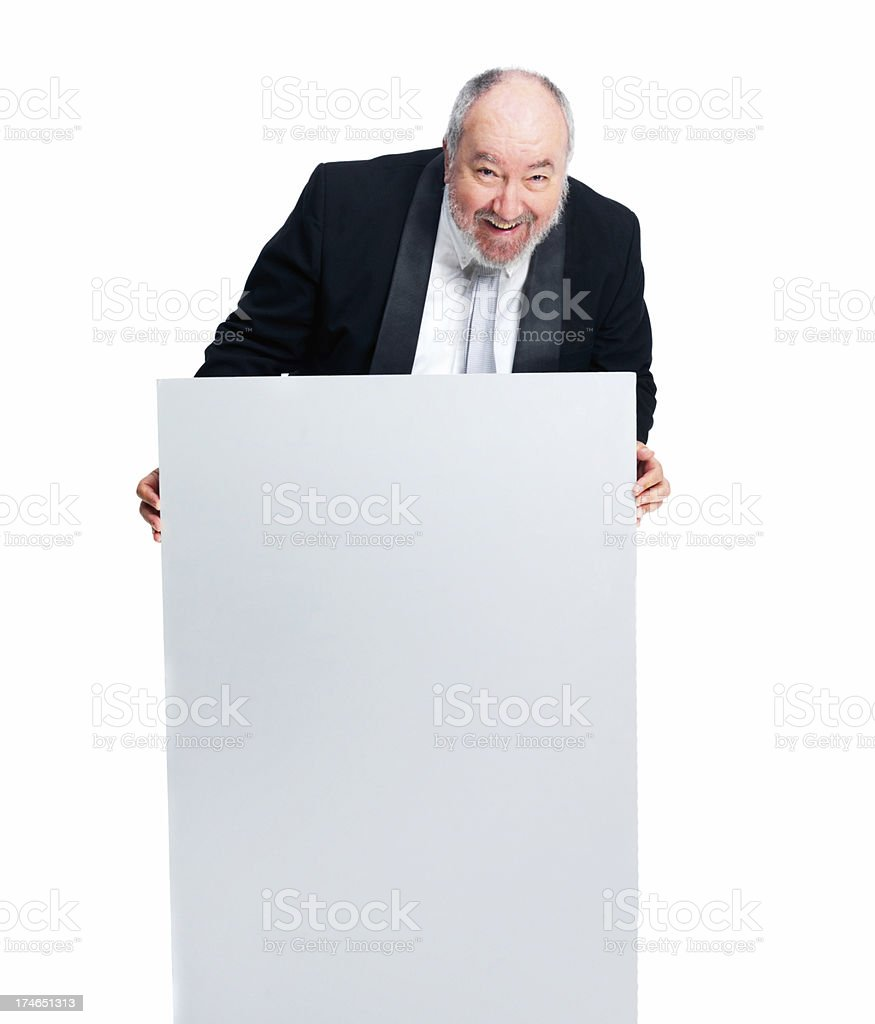 Happy businessman holding a placard royalty-free stock photo