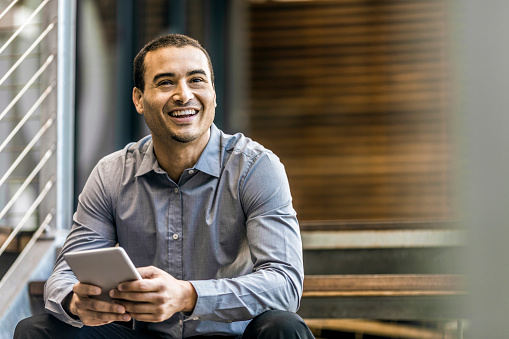 istock Happy businessman holding digital tablet 533430272