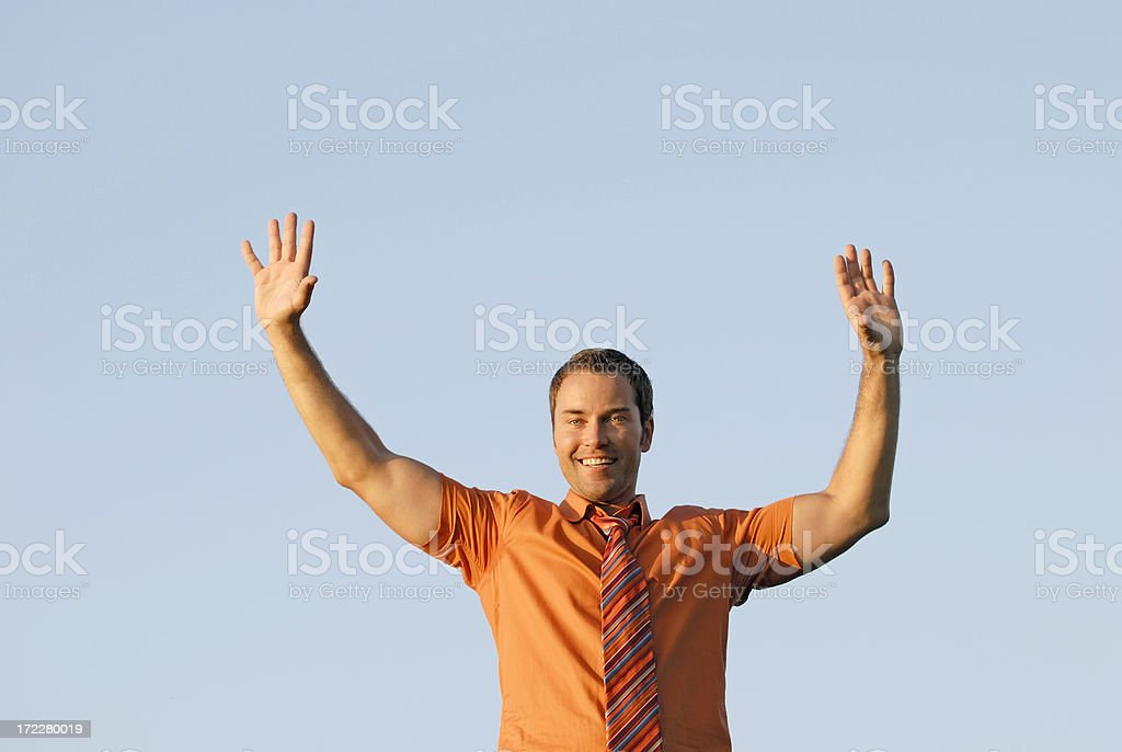 happy businessman holding hands up royalty-free stock photo
