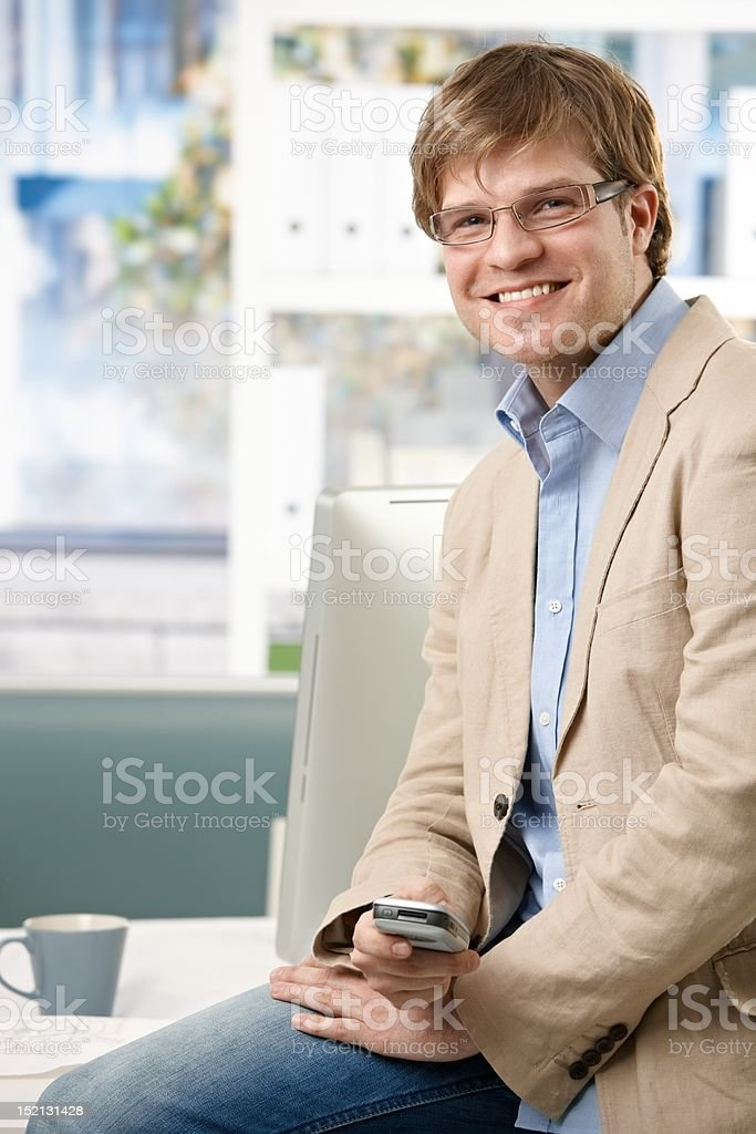 Happy businessman in office royalty-free stock photo