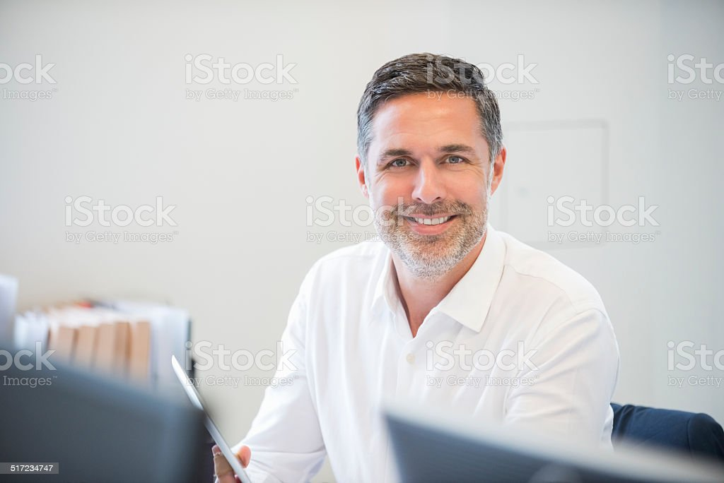 Happy Businessman In Office stock photo