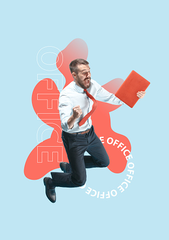 istock Happy businessman jumping and holding laptop 1133602107