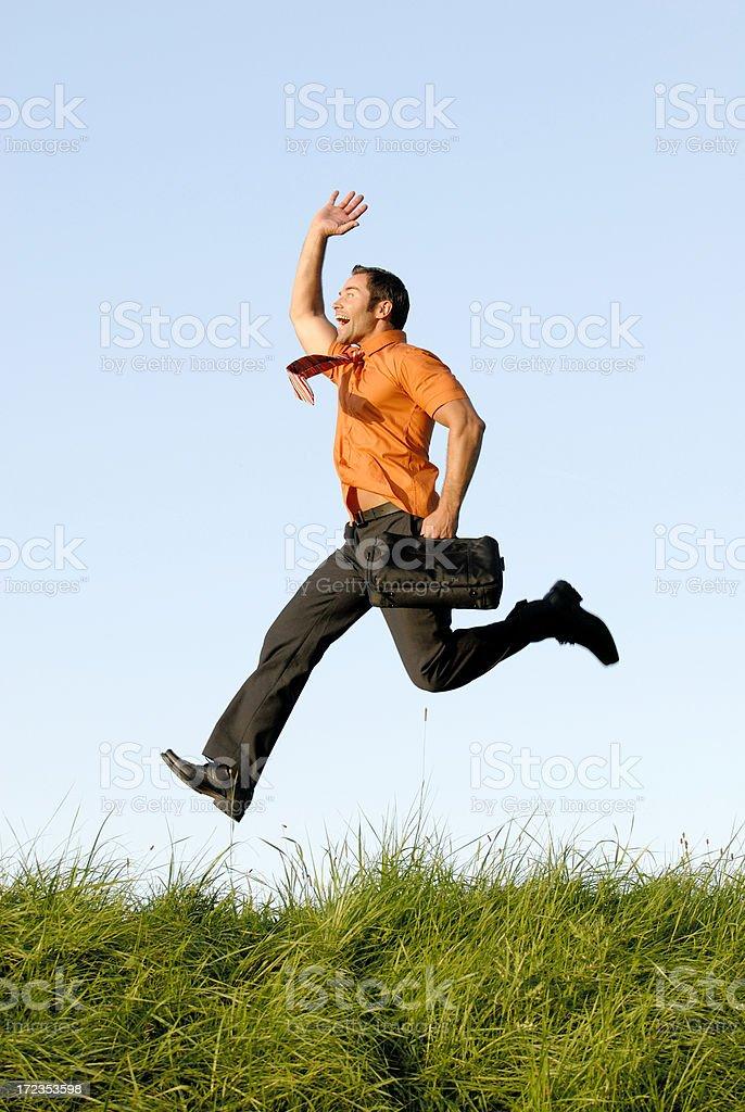 happy businessman jumping royalty-free stock photo