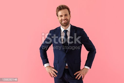 1165538246 istock photo Happy businessman laughing with both hands on his waist 1205252146