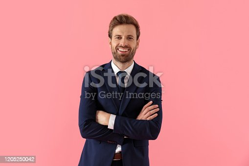 1165538246 istock photo Happy businessman laughing with his hands folded at his chest 1205250042