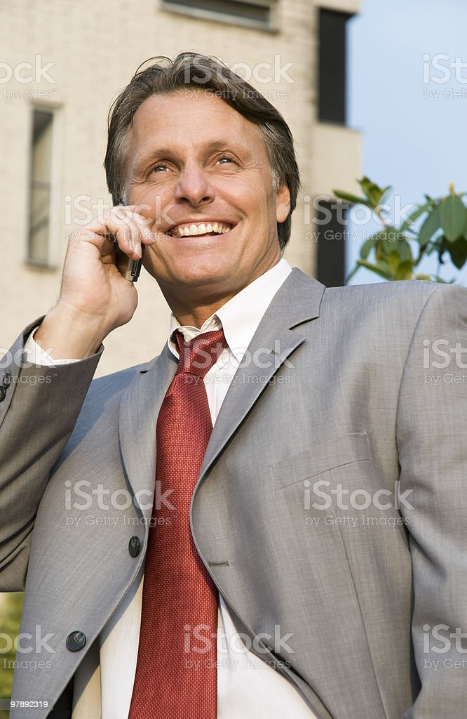 Happy businessman on cellphone royalty-free stock photo