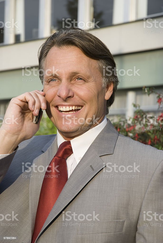 Happy businessman on cellphone. royalty-free stock photo