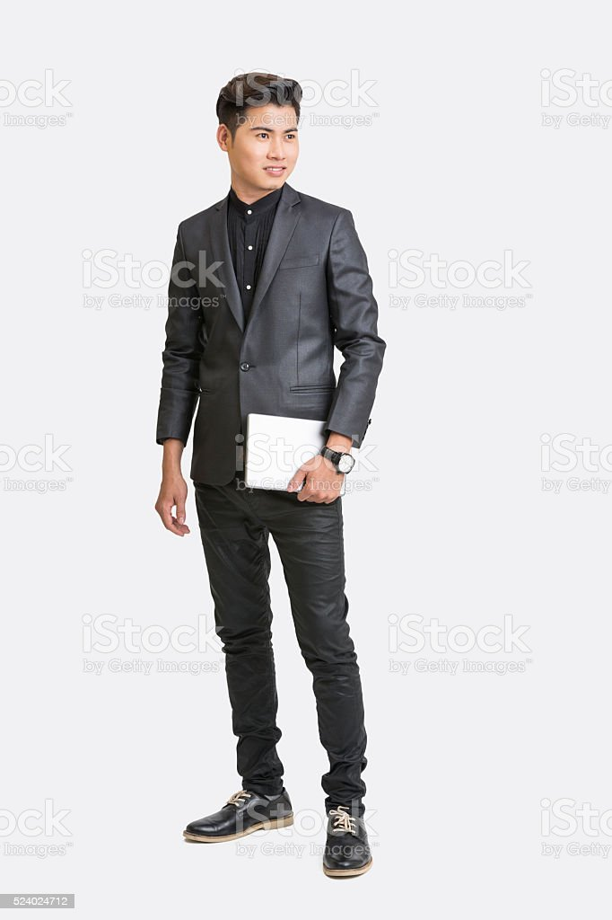 Happy businessman posing with digital tablet stock photo