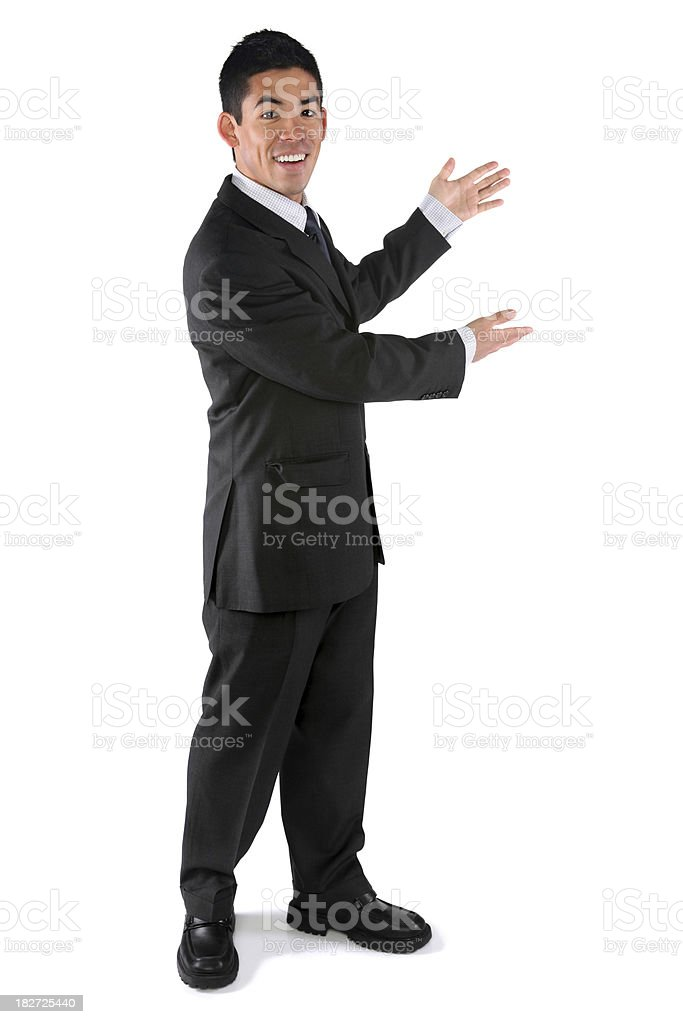 Happy businessman presenting royalty-free stock photo