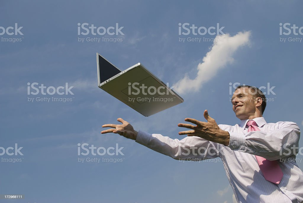 Happy Businessman Reaches Out for Cloud Computing on Laptop royalty-free stock photo