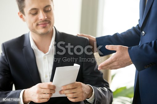 istock Happy businessman receiving white envelope with bribe, bribery corruption concept 804671658