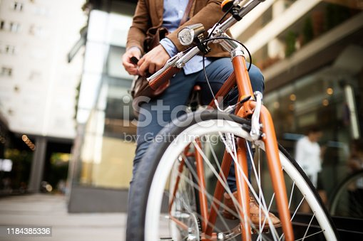 Businessman riding bicycle to work in morning. Way to office.