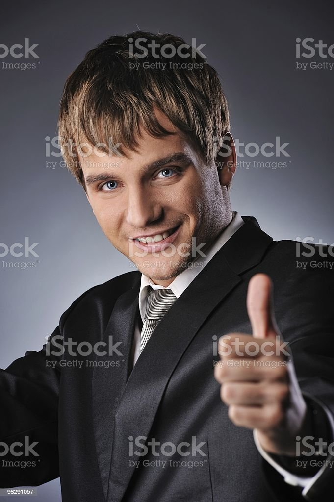 Happy businessman showing his thumb up with smile royalty-free stock photo