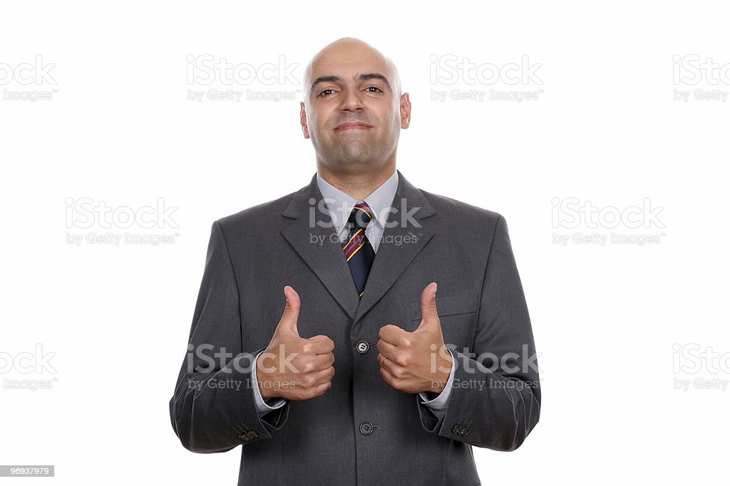 Happy businessman showing thumbs up royalty-free stock photo
