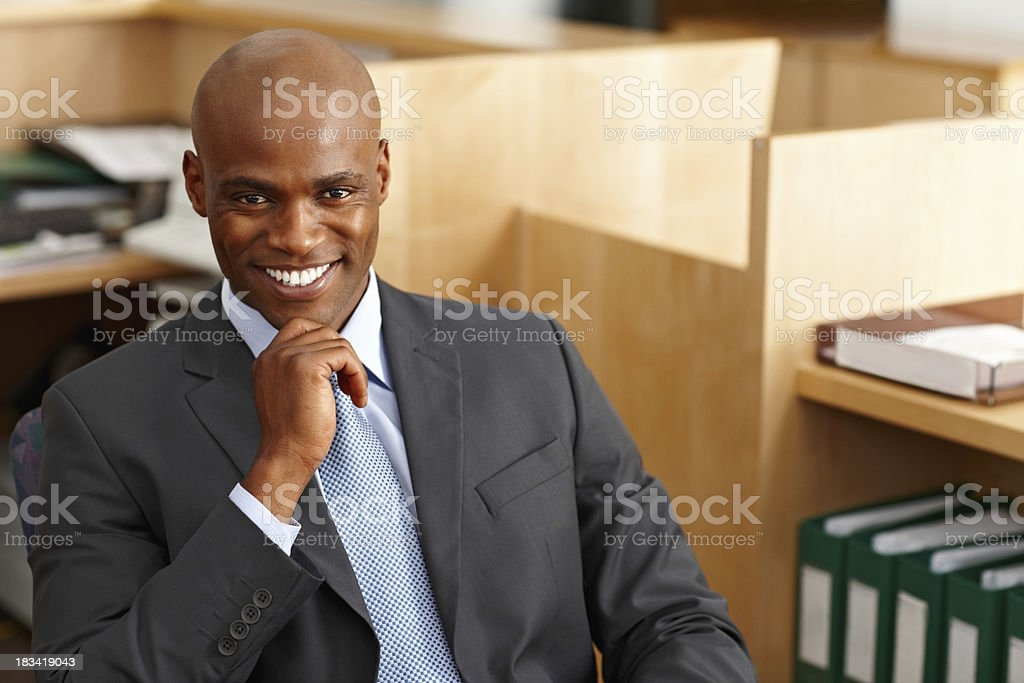 Happy businessman sitting at desk royalty-free stock photo