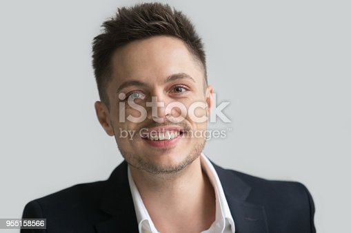 825082848istockphoto Happy businessman smiling at camera 955158566