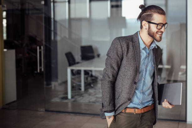 Happy businessman smiling, copy space Happy businessman smiling, copy space man bun stock pictures, royalty-free photos & images
