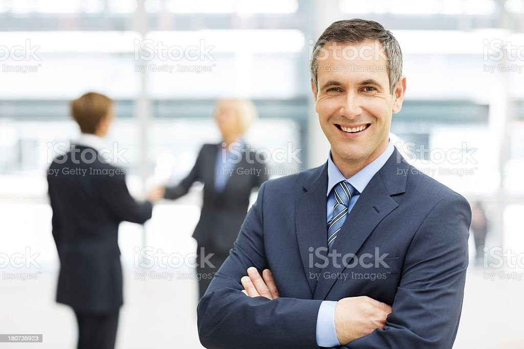 Happy Businessman Standing Arms Crossed royalty-free stock photo