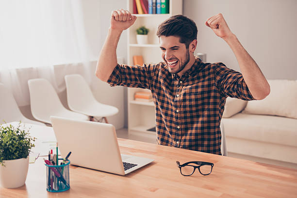 Happy businessman successfuly completed his task and triumphing Happy businessman successfuly completed his task and triumphing with raised hands yeah right stock pictures, royalty-free photos & images