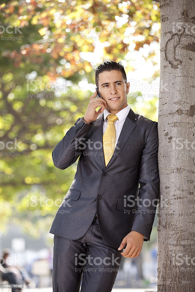 Happy businessman talking at his cellphone royalty-free stock photo